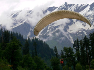 paragliding, cloud covered mountain, trees