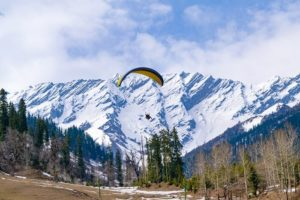 paragliding, mountain in the background