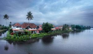 water, houses, cloudy skies