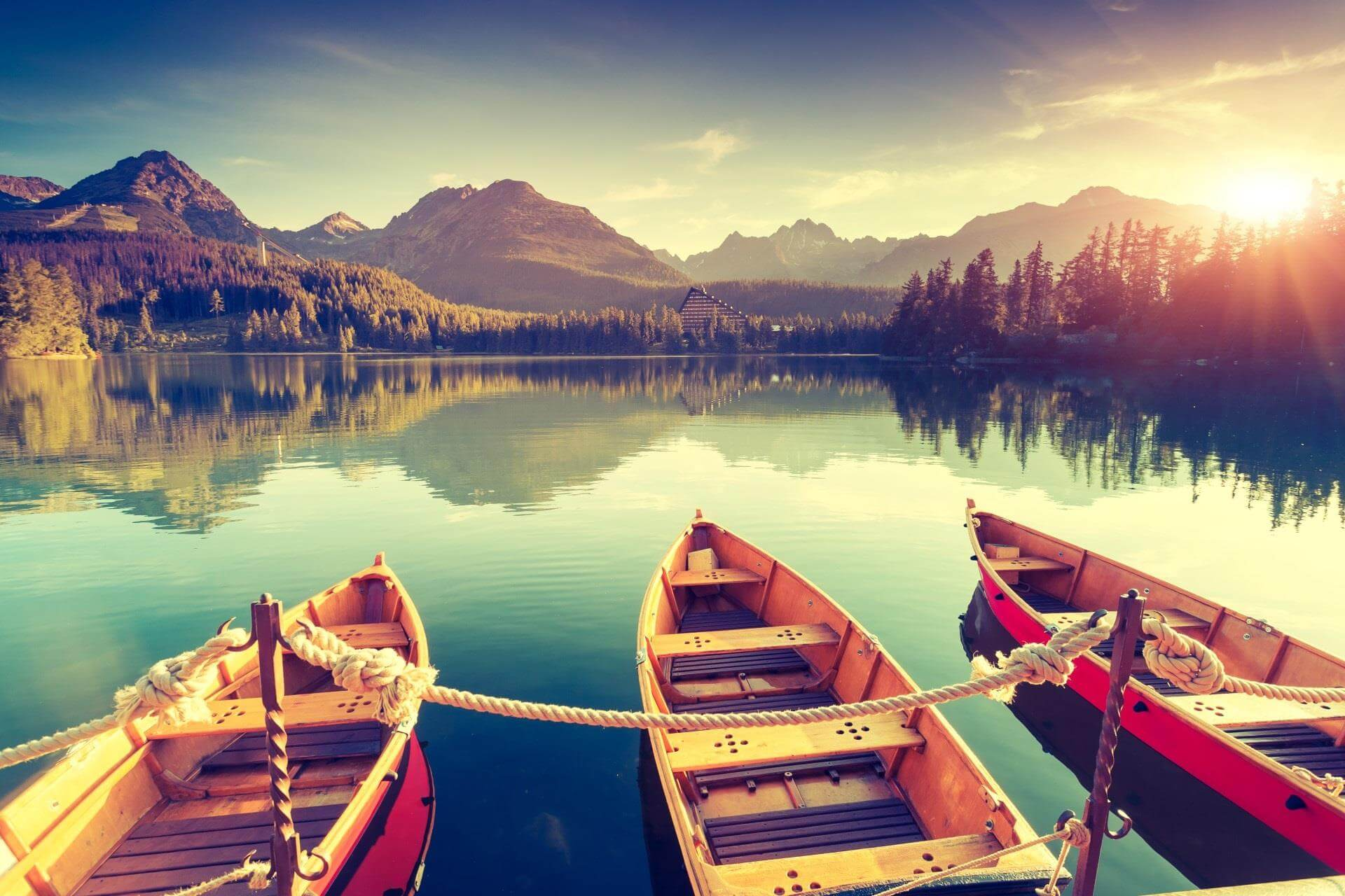 three boats, water, hills, trees