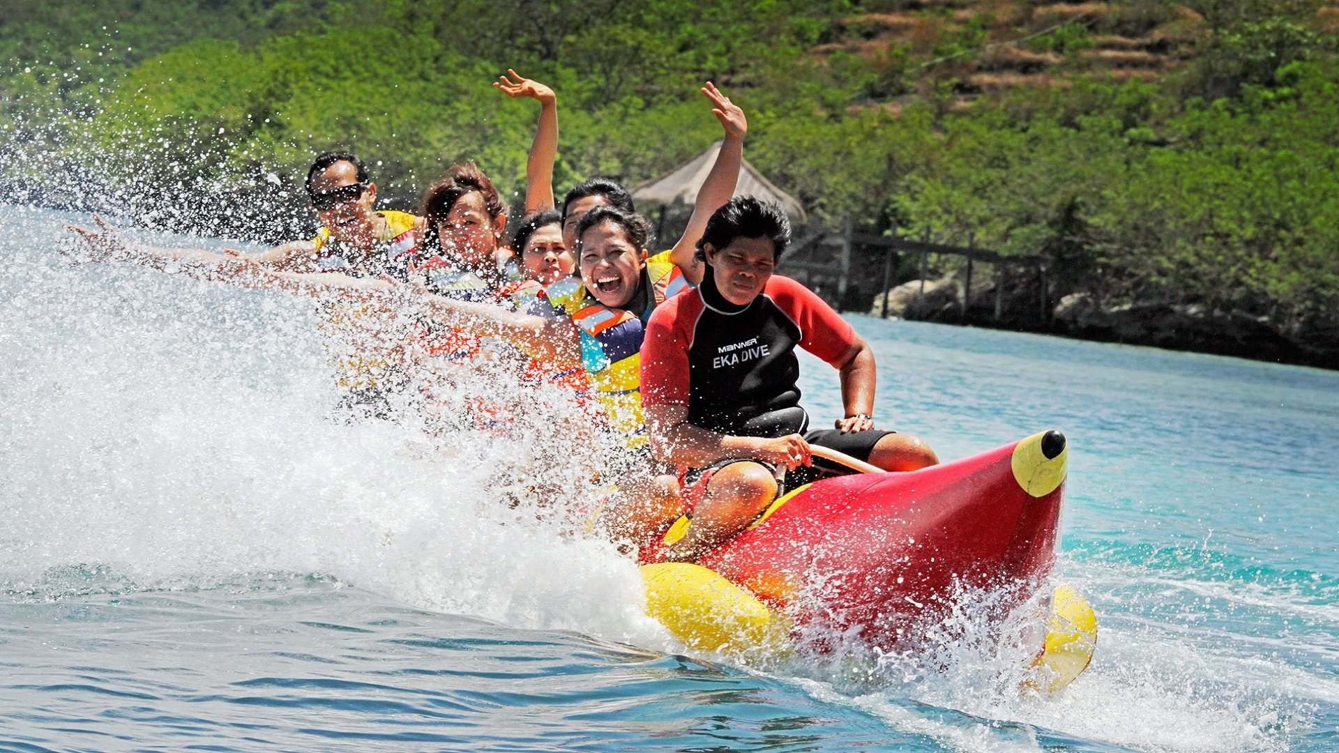 six people riding inflatable banana boat