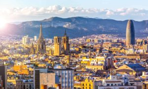 city of spain with mountains as background
