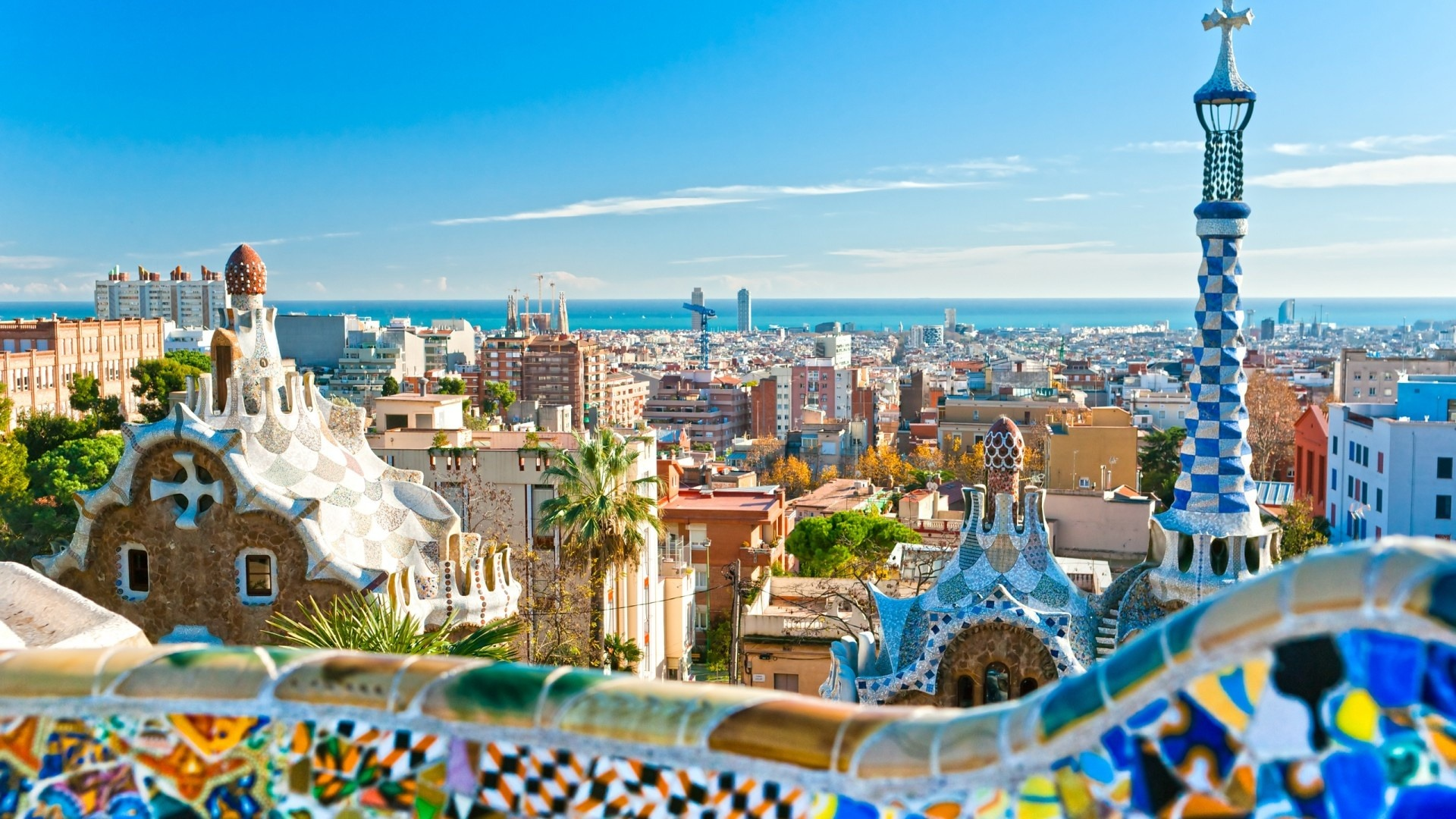 a beautiful view of a city of spain with ocean view afar