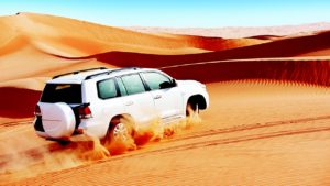 car travelling in sands, dubai