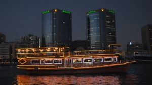 luxury ferry boat on river, two tower buildings