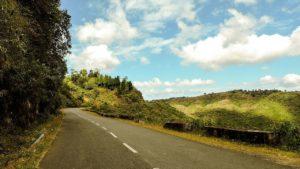 road at shillong beside mountain