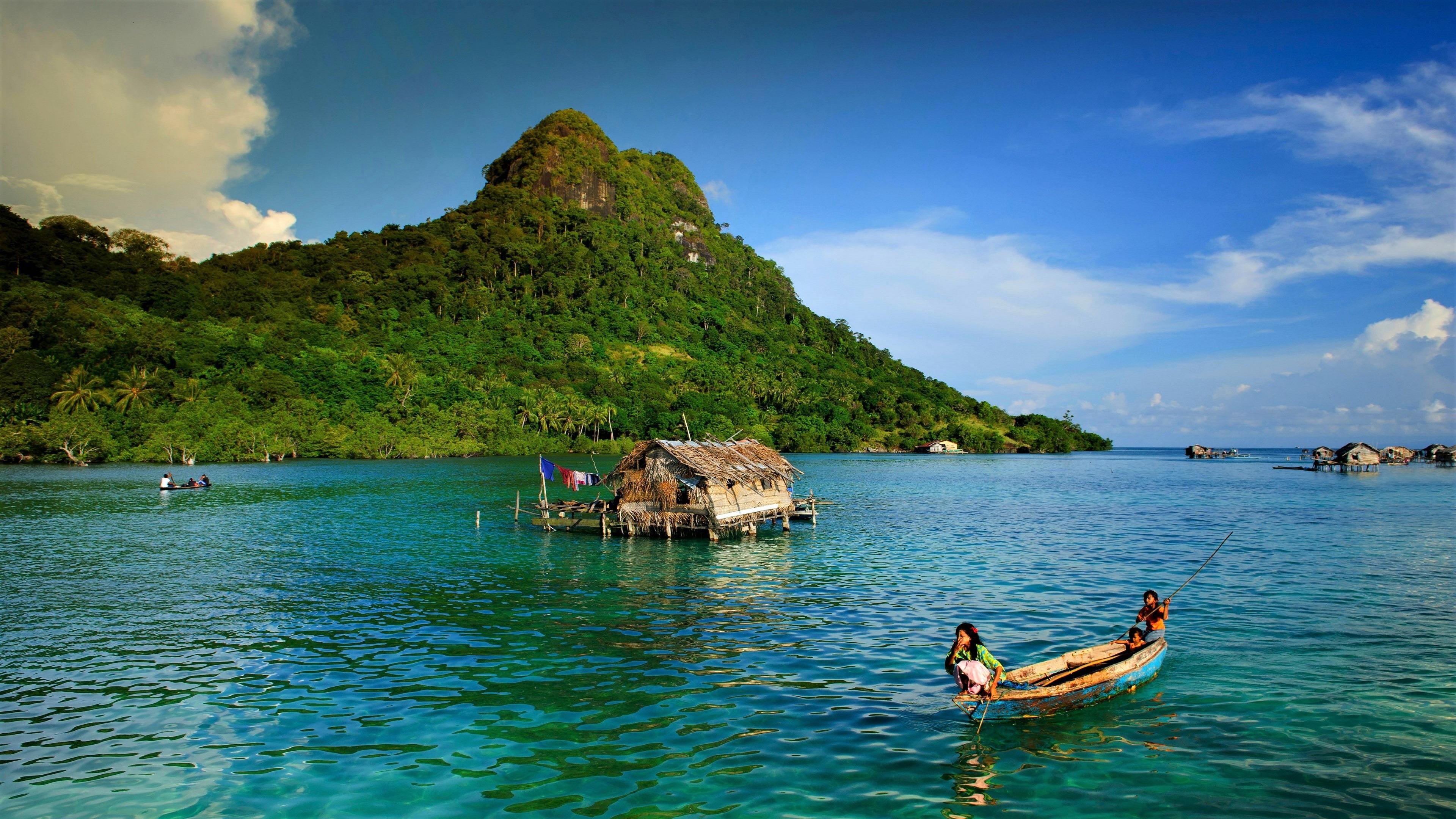 mountain, sea, little huts on the sea,