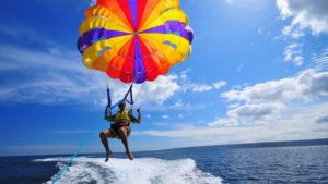 one guy paragliding over the sea