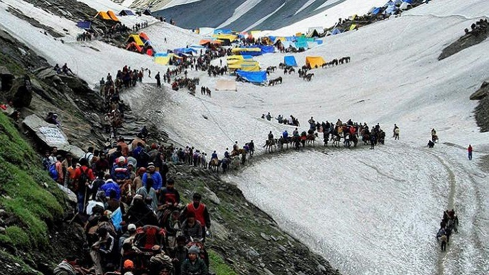 crowd of people camping in a mountain