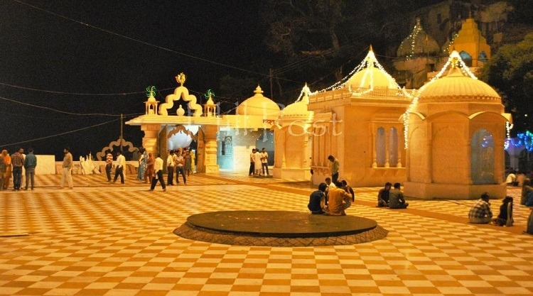 nightview, people roaming and sitting in jawalaji temple