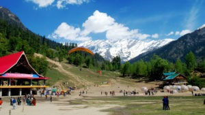 people sightseeing and paragliding in the himachal mountain