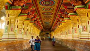 inside a temple of kerala, three people visiting