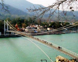 people crossing the ramjhula bridge