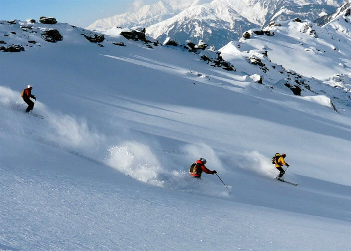 people skiing in the mountains