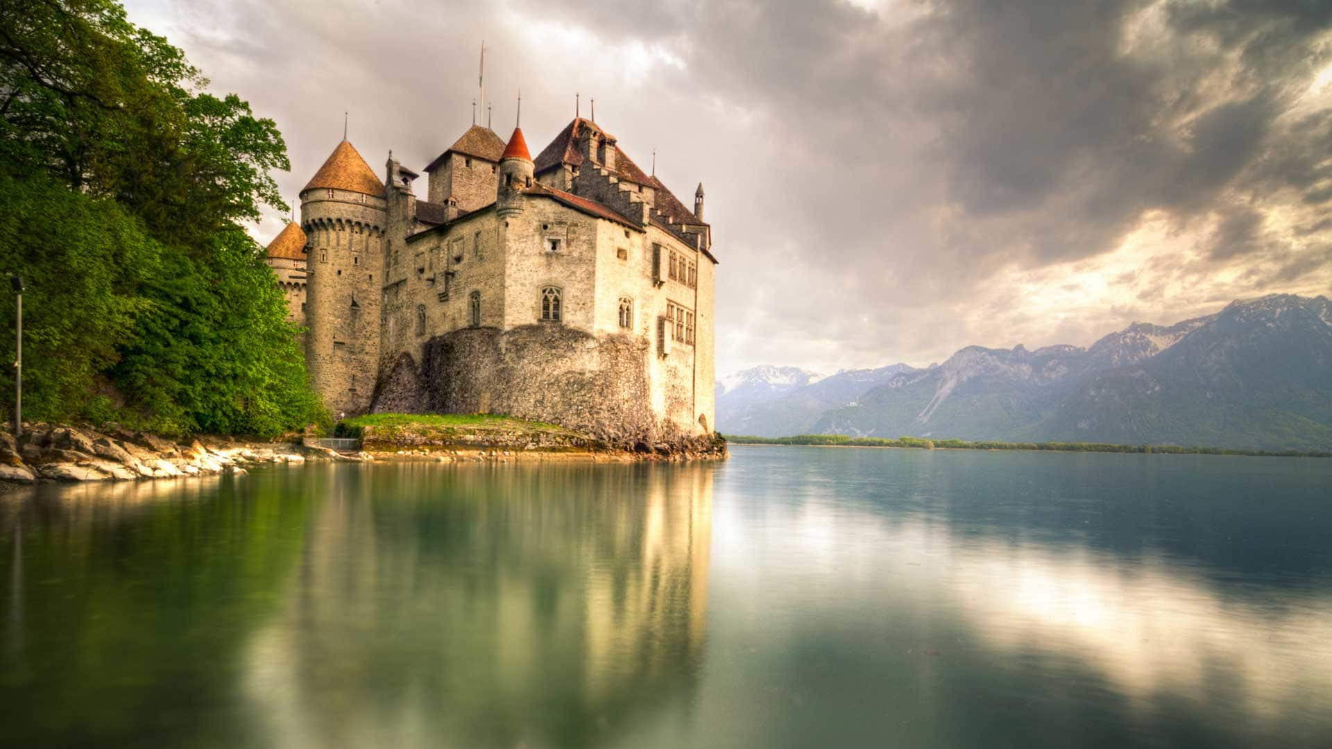 castle, water body beside mountains
