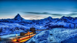 mountain view, train passing through a station