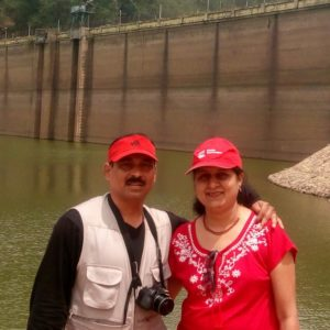couple in front of a dam
