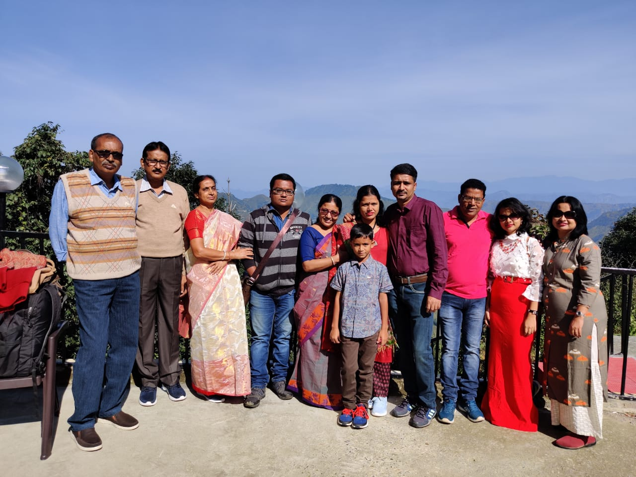 people posing with shimla's skies on the background